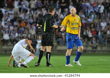 SIOFOK, HUNGARY - AUGUST 9: Fulop (R) talks with the referee at a Hungarian National Championship soccer game Siofok vs. Ujpest SC August 9, 2008 in Siofok, Hungary.