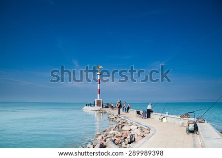 Siofok, Hungary - September 2014. Many man fishing on a pier in Siofok, a city on the Lake Balaton.
