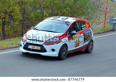 SION, SWITZERLAND - OCTOBER 30:  Mugnier of Lugano Racing Team in a Ford  Fiesta at International Rally of the Valais : October 30, 2011 in Sion Switzerland