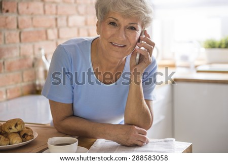 Sip of coffee and talk on the phone - stock photo