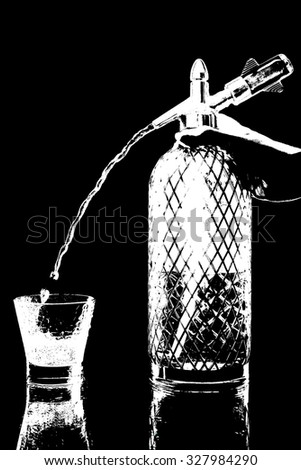 siphon with soda copulation on the table on a black background with a full glass, jet and drops - stock photo