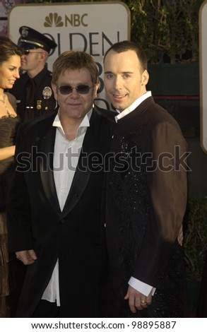 SIR ELTON JOHN (left) & partner DAVID FURNISH at the 61st Annual Golden Globe Awards at the Beverly Hilton Hotel, Beverly Hills, CA. January 25, 2004