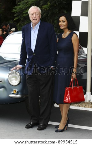 "Sir Michael Caine and wife, Shakira arriving for the ""Cars 2"" pre premiere party at Whitehall Gardens, London. 17/07/2011 Picture by: Steve Vas / Featureflash"