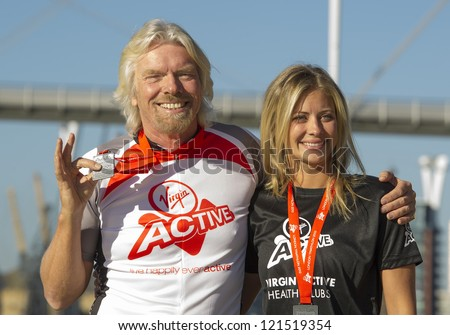 Sir Richard Branson and Holly Branson at the The Virgin Triathlon 2012, Excel Arena,  Docklands, London. 22/09/2012 Picture by: Simon Burchell - stock photo