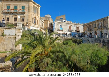 SIRACUSA, ITALY - JANUARY 03 2015,: Arethuse Fountain and baroque architecture in Ortigia Old Town of Siracusa, Sicily. Shot in 2015  - stock photo