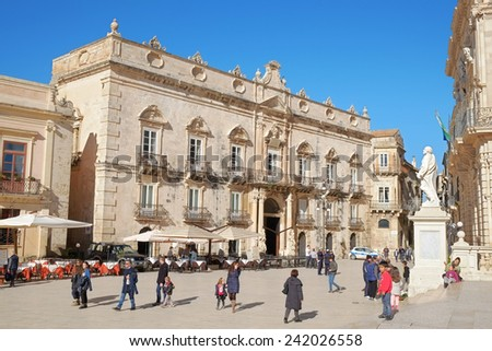 "SIRACUSA, ITALY - JENUARY 03, 2015: baroque architecture of Palace ""Beneventano del Bosco"" in crowned main square of Ortigia Old Town of Siracusa, Sicily.  - stock photo"