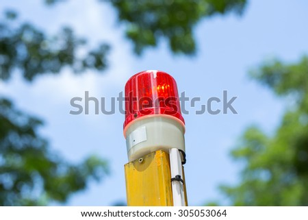 siren in the park,blue sky background - stock photo