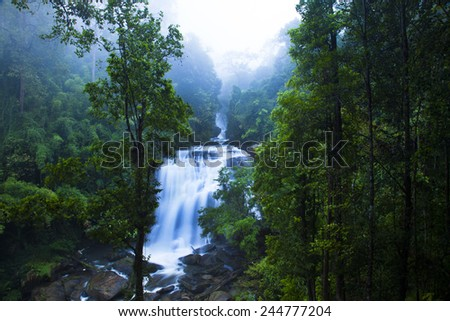 Siripoom Waterfall The beautiful waterfall is in fact a pair of falls which plunge from a towering cliff. Doi Inthanon National Park  Chom Thong Chiang Mai, Thailand. - stock photo
