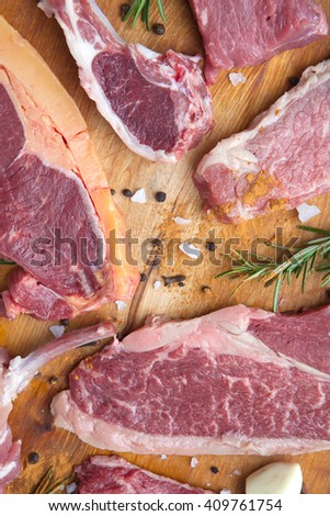 sirloin and tenderloin beef with herb and  ingredient on wooden plate - stock photo