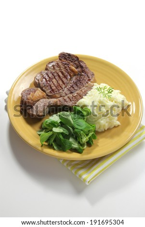 sirloin steak with mashed potato and salad - stock photo