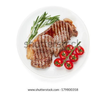 Sirloin steak with rosemary and cherry tomatoes on a plate. Isolated on white background - stock photo