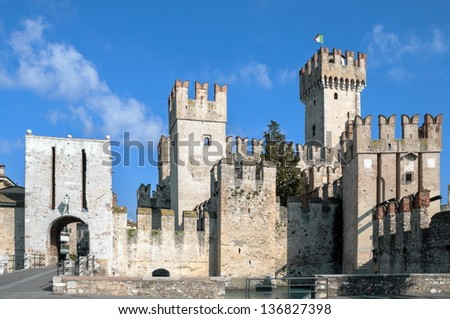 Sirmione Scaliger castle on garda Lake in Italy - stock photo