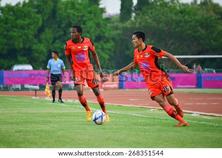 SISAKET THAILAND-APRIL 4: Kittipong Wongma (no.29) of Sisaket FC. in action during Thai Premier League between Sisaket FC and Thai Port FC at Sri Nakhon Lamduan Stadium on April 4,2015,Thailand - stock photo