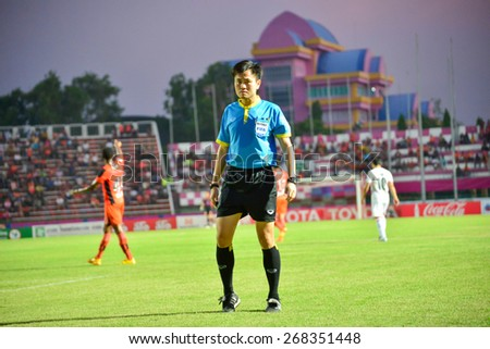 SISAKET THAILAND-APRIL 4: Referee on soccer match during Thai Premier League between Sisaket FC and Thai Port FC at Sri Nakhon Lamduan Stadium on April 4,2015,Thailand - stock photo