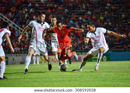 SISAKET THAILAND-AUGUST 19:Durosinmi (orange) of Sisaket FC. in action during  Thai Premier League between Sisaket FC and SCG Muangthong united at Sri Nakhon Lamduan Stadium on August 19,2015,Thailand - stock photo