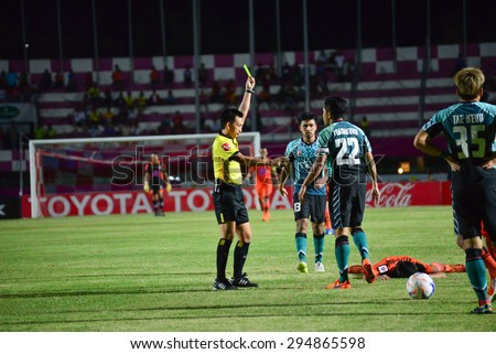 SISAKET THAILAND-JULY 4: referee on soccer match show yellow gard during  Thai Premier League between Sisaket FC and Chainat Hornbill FC at Sri Nakhon Lamduan Stadium on July 4,2015,Thailand - stock photo