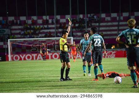 SISAKET THAILAND-JULY 4: referee on soccer match show yellow gard during  Thai Premier League between Sisaket FC and Chainat Hornbill FC at Sri Nakhon Lamduan Stadium on July 4,2015,Thailand - stock photo