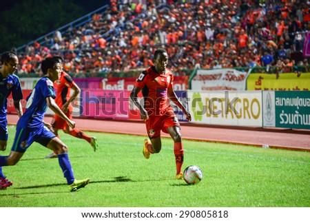 SISAKET THAILAND-JUNE 21: Durosinmi Gafar (orange) of Sisaket FC. in action during  Thai Premier League between Sisaket FC and Navy FC at Sri Nakhon Lamduan Stadium on June 21,2015,Thailand - stock photo
