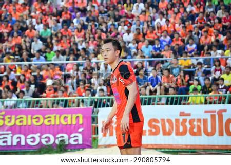 SISAKET THAILAND-JUNE 21: Khapfa Boonmatun (orange) of Sisaket FC. in action during  Thai Premier League between Sisaket FC and Navy FC at Sri Nakhon Lamduan Stadium on June 21,2015,Thailand - stock photo