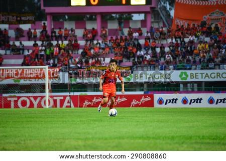 SISAKET THAILAND-JUNE 21: Nuttawut Khamrin of Sisaket FC. in action during  Thai Premier League between Sisaket FC and Navy FC at Sri Nakhon Lamduan Stadium on June 21,2015,Thailand - stock photo