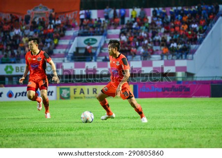 SISAKET THAILAND-JUNE 21: Tatree Siha (no.20) of Sisaket FC. in action during  Thai Premier League between Sisaket FC and Navy FC at Sri Nakhon Lamduan Stadium on June 21,2015,Thailand - stock photo