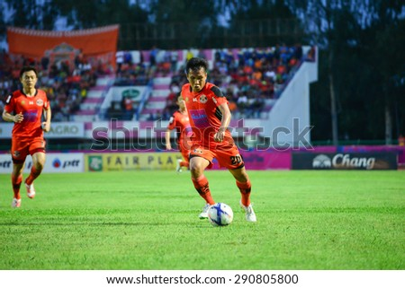 SISAKET THAILAND-JUNE 21: Tatree Siha (orange) of Sisaket FC. in action during  Thai Premier League between Sisaket FC and Navy FC at Sri Nakhon Lamduan Stadium on June 21,2015,Thailand - stock photo