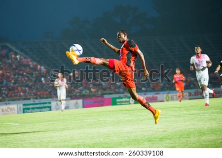 SISAKET THAILAND-MARCH 7: Durosinmi Gafar (orange) of Sisaket FC. in action during Thai Premier League between Sisaket FC and Gulf Saraburi FC at Sri Nakhon Lamduan Stadium on March 7,2015,Thailand - stock photo