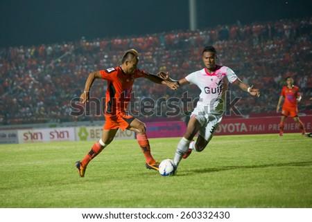 SISAKET THAILAND-MARCH 7: Jirawat Daokhao (orange) of Sisaket FC. in action during Thai Premier League between Sisaket FC and Gulf Saraburi FC at Sri Nakhon Lamduan Stadium on March 7,2015,Thailand - stock photo