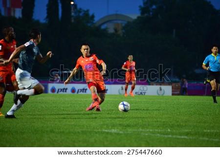 SISAKET THAILAND-MAY 3: Khapfa Boonmatun (orange) of Sisaket FC. in action during Thai Premier League between Sisaket FC and Chiang rai united at Sri Nakhon Lamduan Stadium on May 3,2015,Thailand - stock photo
