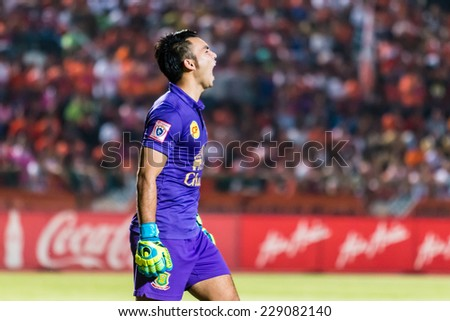 SISAKET THAILAND-OCTOBER 29: Sarawut Konglarp of Army Utd. in action during Thai Premier League between Sisaket FC and Army Utd at Sri Nakhon Lamduan Stadium on October 29,2014,Thailand - stock photo
