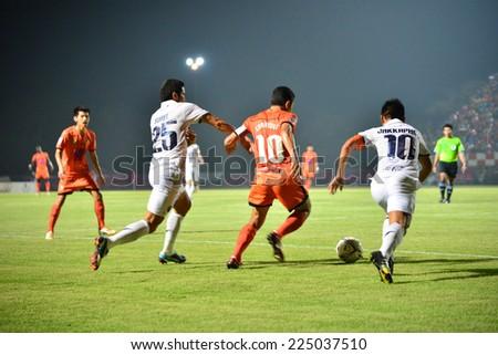 SISAKET THAILAND-October 15: Sarayuth Chaikamdee (No.10) of Sisaket FC. in action during Thai Premier League between Sisaket FC and Buriram Utd at Si Nakhon Lamduan Stadium on October 15,2014,Thailand - stock photo