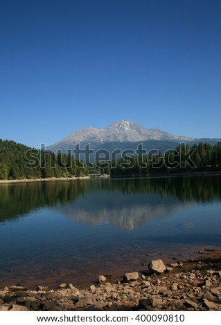 Siskiyou Lake with Mount Shasta in the background.  - stock photo