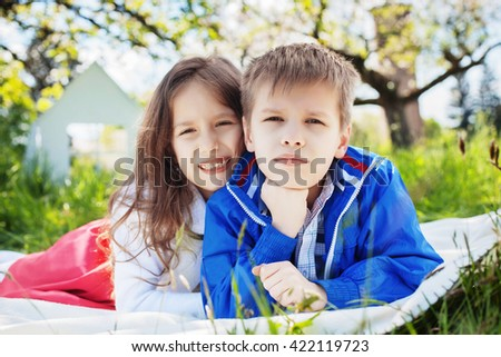 sister and brother on a picnic