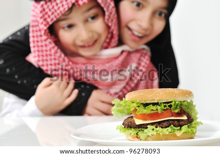 Sister and brother with Burger - stock photo