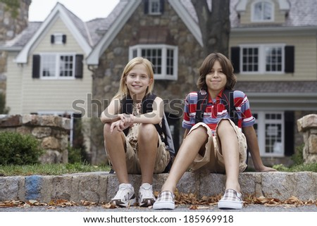 Sister and brother with school bags, Chatham, New Jersey, USA - stock photo
