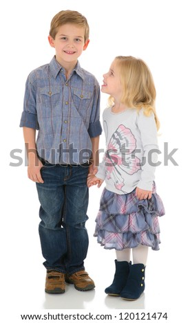 Sister Looking up to her Happy Brother holding hands - stock photo