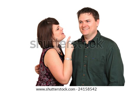 Sister making a point to her brother - stock photo