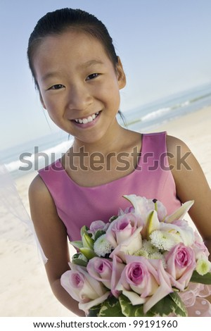 Sister of Bride on Beach - stock photo