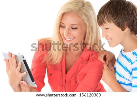 Sister showing brother tablet  - stock photo