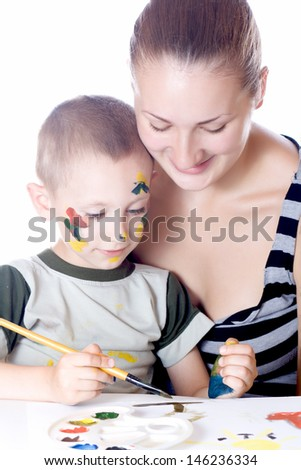 Sister teaches brother to paint - stock photo