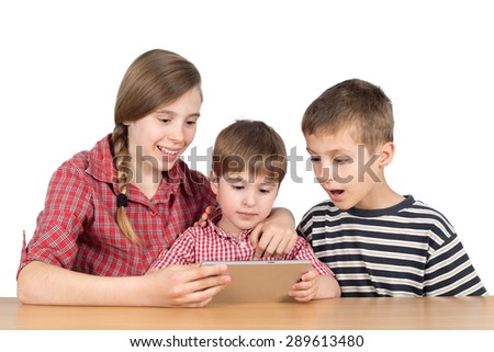 Sister Teaching Her Younger Brother to Use Tablet, Half-Length Studio Shot Isolated on White  - stock photo