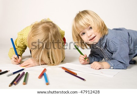 Sisters drawing pictures - stock photo