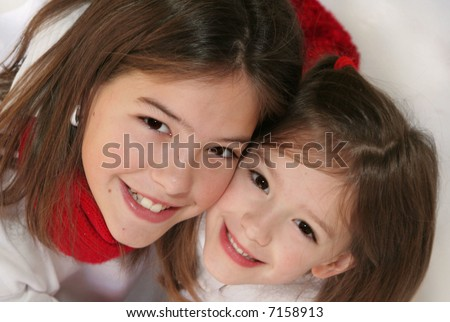 sisters excited about christmas - stock photo