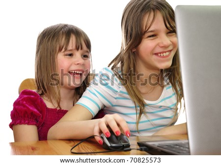 Sisters fun with laptop - stock photo