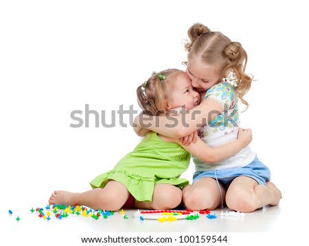 sisters girls playing and embracing over white background - stock photo
