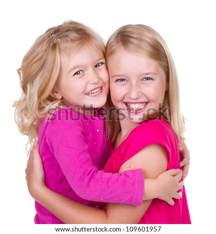 sisters hugging isolated on white