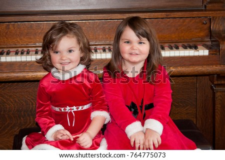 Sisters red christmas holiday dresses sitting stock photo royalty