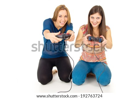 sisters play video games on the joysticks - stock photo