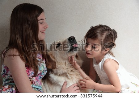 sisters playing with your dog