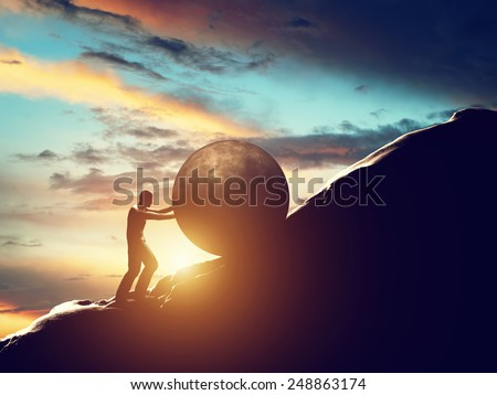 Sisyphus metaphor. Man rolling huge concrete ball up hill. Sisyphean work, task.  - stock photo